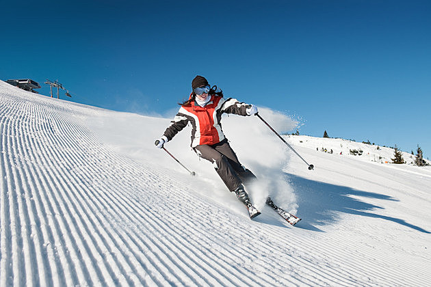 Skiing lady on modified piste